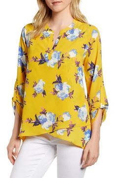 Free shipping and returns on Gibson x Living in Yellow Erin Crossover Tunic (Regular & Petite) (Nordstrom Exclusive) at Nordstrom.com. From Gibson's collaboration with popular lifestyle and fashion blogger Erin Schrader, this flowy stretch-crepe tunic is a go-to for everyday elegance and ease with roll-tab sleeves and crisscrossed hem panels.