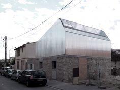 metal facade to contrast the limewash masonary base // BAST