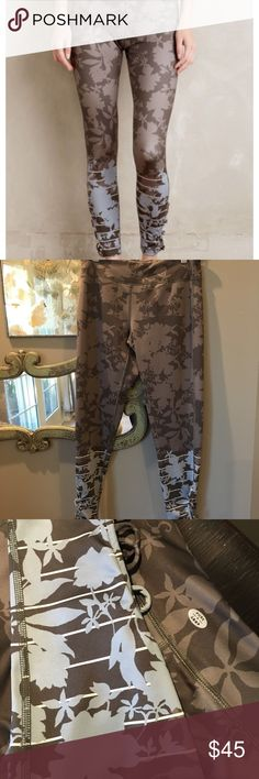 Anthropologie Pure & Good floral leggings Sz S Anthropologie sport brand Pure & good size small leggings in taupe, Brown & blue floral print. Laced ankles. Never worn, New Condition, no Tags Anthropologie Pants Leggings