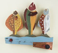 Dancing Fish 1 is a whimsical, wall mounted folk art piece by contemporary American folk artist, Jim Dixon. It depicts a dancing sole, cod & salmon. Go to www.jimdixonartist.com to watch them dance!