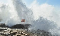 Rocky grounds in front the vintage Hotel of Ericeira, Portugal, are often hit by powerful waves.