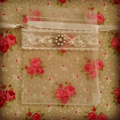 A beautiful embellished organza wedding ring bag with Italian Lace and Pearl detail.  Keep those wedding rings safe and together in the best mans pocket!