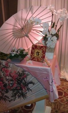 Asian-inspired wedding decor. i can def find some white asian umbrellas