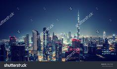 Beautiful Dubai cityscape, bird's eye view on a night urban scene, modern city panoramic landscape, United Arab Emirates