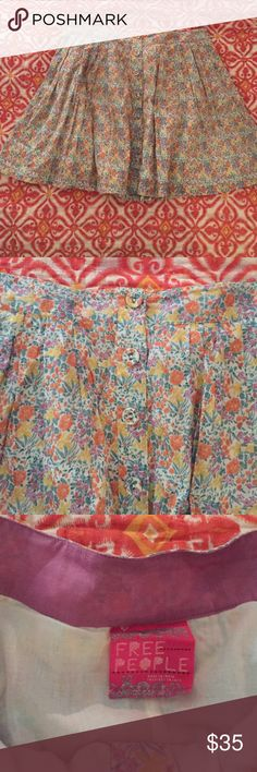 FREE PEOPLE Pleated Button Down Floral Skirt Free people pleated skirt that buttons all the way down. Cute for spring with sandals or fall with boots. Worn once. No signs of wear. Free People Skirts