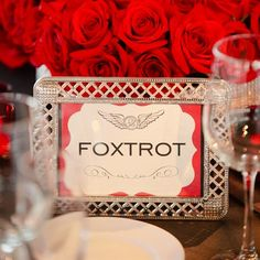 TABLE NAMES INSTEAD OF NUMBERS! - Each table was named with airplane pilot lingo and set in a bejeweled frame for this wedding -I REALLY LIKE THIS IDEA WOULD DO IT WITH FAMOUS 49ERS PLAYERS/COACHES PAST & PRESENT