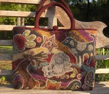 Hooked rug tote bag.  Be still my heart!  I have to make me a carpetbag!  I cannot stand it til I own one.  This is a beauty.