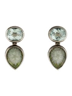 $140.00 Sterling silver Stephen Dweck earrings featuring bezel set oval topaz with mother of pearl quartz doublet, carved flower motif center and ear clip closures.