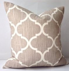 One decorative throw pillow cover. The front of the cover is a lattice print in shades taupe and cream. This is a home decor cotton fabric. The back of