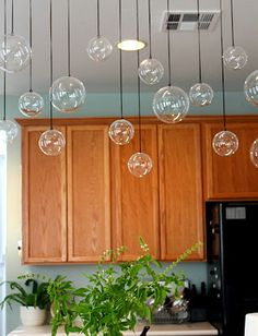 Hanging Plastic globes from the ceiling (but from fishing wire instead of the black strings) would look like bubbles!