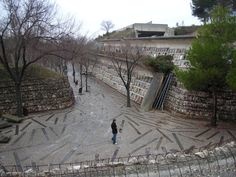 Built by Enric Miralles  in Barcelona, Spain with date 1994. Images by Flickr user : Andrew Kroll. As part of a competition to replace an older cemetery, Enric Miralles and Carme Pinos envisioned a new type of cemete...