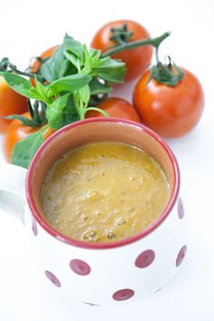 Sweet Cherry Tomato and Roasted Pepper Soup      1 red pepper     1 yellow pepper     1 small red onion     2 cloves of garlic, peeled     12 cherry tomatoes, stalks removed     1 tablespoon of vegetable oil     1 vegetable stock cube     Crushed black pepper (Does involve heat & a blender)