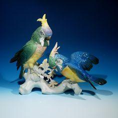 Colourful vintage Karl Ens porcelain Cockatoo Group - displaying on branch.