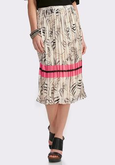 Entice and excite in this alluring midi skirt, featuring a Cato exclusive palm frond print highlighted with bold stripes and perfectly placed pleats. #catofashions #mycatostyle #palm #palmprint #popofcolor #neon #pink #ootd