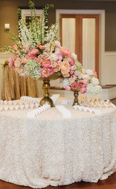 Photographer: Natalie Franke Photography; Beautiful pink, white and green wedding reception centerpiece;