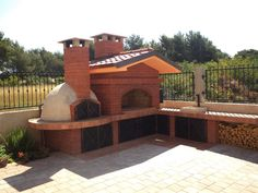 barbecue with wood-fired brick oven