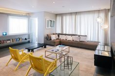 Meticulously Renovated Apartment Takes Advantage Of Color And Chic Accent Features