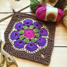 The African flower granny square crochet designs are beautiful! I love working with #lionbrand mini Bon Bon #yarn #crochet #grannysquare #lovetocrochet #crafts