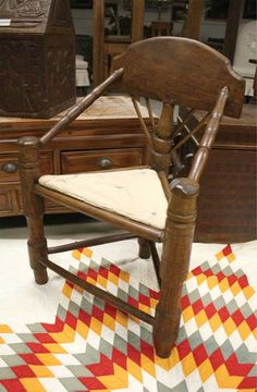 "GEORGE COLE AUCTIONS RED HOOK, 845-758-9114  ""This is an oak wood pilgrim chair—all pegged. I really love this chair because it's so whimsical and unique. The angles and the primitiveness of the chair really make it a favorite."""