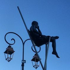 Nicolas Lavarenne Figurative Sculptures Balance Precariously on the Streets of the French village of Mougins