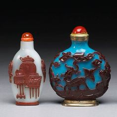 Two overlay decorated Peking glass snuff bottles