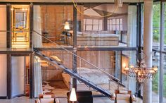 Glass walls, drapes, steel staircase, modern chalet love