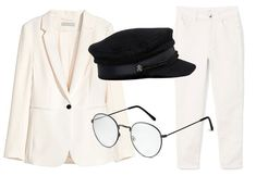 A classic trouser suit styled with baker boy hat