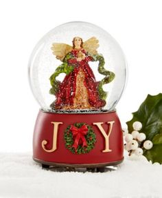 """Holiday Lane Angel Joy Musical Snow Globe, Only at Macy's $14.99 The word """"Joy"""" graces the base of this musical snow globe. The snow globe plays """"Silent Night"""" and makes a great gift of faith for a friend."""