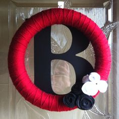 Inspired by many wreaths on pinterest. Wrapped yarn around a foam wreath, added some flowers, and hung our initial behind it. kellybartlett