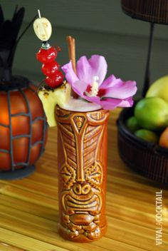 Thurston Howl  1 oz Appleton Estate V/X rum  1/2 oz Paul Masson Grande Amber VSOP brandy  1/2 oz Tangueray Rangpur gin  2 oz pineapple juice  1/4 oz grapefruit juice  2 oz papaya nectar  1/4 oz Trader Tiki's cinnamon syrup  1/2 oz ginger syrup    Fill a shaker full of ice. Add the rum, brandy, gin, juices, nectar and syrups. Cap the shaker and shake vigorously for 15-20 seconds. Pour into a tiki mug. Garnish with pineapple, cherries, cinnamon stick and a hibiscus flower.