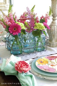 Mason Jar Centerpieces | Looking for rustic table decor ideas for a summer table setting? This summer table combines floral dishes with mason jar flowers in a colorful tablescape. -----> #designthusiasm #tablesettings #tabledecorations #tablescapes #tablecenterpieces #tabledecor #tablesettingideas #rustictablesettings #farmhousetablesettings #casualtablesettings #beautifultablesettings #colorfultablesettings #summerflowers #summertablesettings #outdoortablescapes #masonjarcenterpiece