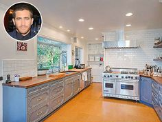 Look Inside These Gorgeous Celebrity Kitchens | JAKE GYLLENHAAL | The kitchen in the actor's $3.5-million L.A. compound is modern and a bit masculine-looking, with open shelving and simple accents like white subway tile and light blue cabinetry.