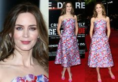Emily Blunt showed off her assets and post-baby curves in stunning peaked neckline of the head-to-toe strapless dress.