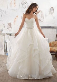 Morilee by Madeline Gardner 'Marissa' 5504 | This Dreamy Organza Ballgown Features a Flounced Skirt with Horsehair Trim. Removable Crystal Beaded Satin Belt Included (Crystal Beaded Satin Belt Also Sold Separately as Style #11254). Available in Three Lengths: 55″, 58″, 61″. Colors Available: White, Ivory, Ivory/Light Gold.