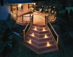 I would love to expand our deck out back. Ours is almost too small to even hold a patio set with umbrella, and seeing as we like to entertain, it would be nice to have more room on the deck. This picture is an example. Outdoor Deck Lighting, Stair Lighting, Outdoor Light Fixtures, Outdoor Decking, Lighting Ideas, Trex Decking, Outdoor Stairs, Lighting Design, Landscape Lighting