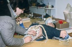 """Alec Gillis tests the """"ripped-in-half"""" Bishop prosthetic makeup effect from ALIENS on fellow artist Julian Caldow."""