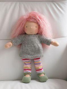 Ravelry: Amelia Doll Tunic pattern by Kristin Maw Tunic Pattern, Free Pattern, Dk Weight Yarn, Waldorf Toys, Ravelry, Little Doll, Dollhouse Dolls, Knitted Dolls, Soft Dolls