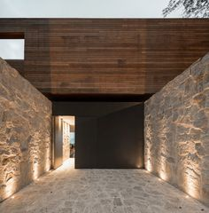 "larameeee: (via Alex Lerner's ""Purist Paradise""). Architecture Doors black stone walls Lighting wood Facades Steal Pavements bjad"
