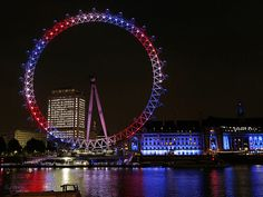 The London Eye Ferris wheel is illuminated in shades of the U.K.'s red, white and blue on Monday night to mark the birth of Duchess Catherine and Prince William's new baby boy, the Prince of Cambridge.