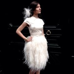 Wedding dress with ostrich feathers by maison Arthur Aquino and cuff bracelet by Philippe Le Meur