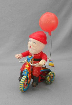 Vintage Christmas Collectible ~ Suzuki Mechanical Tin Litho Toy ~ Santa on Tricycle. Circa, 1950's. Wind the key and Santa Claus zips along and the bell rings.