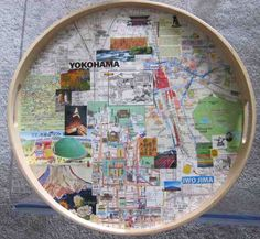 Modpoge serving trays with travel brochures/maps:  I could have a collage area of the users places and destinations they have been too - the app keeps track of this and saves all your favourite places around the globe