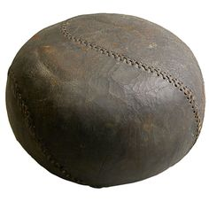 Medicine Ball  United States.  Late 19 th century  Worn and oiled by the hands of use, an exercise ball unusual in profile and stitch