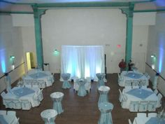 View of a wedding reception for 200 people at G2 Gallery.  This arrangement allowed for mingling in the middle of the floor, with cocktail tables, and seating along the outside of the room.  A sweethearts' table is set for the bride & groom.