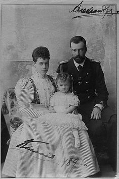 1897 Grand Duchess Xenia Alexandrovna, sitting with her husband, Grand Duke Alexander Mikhaelovitch and their daughter Princess Irina