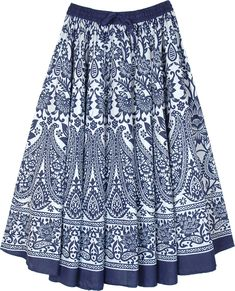 A fun vacation skirt with a vibrant big blue paisley print with flowers in white, this mid length skirt has a lot of fabric and is voluminous and feminine. It sways beautifully when you walk because of the amount of fabric and gathers on the waist. #tlb #JuniorPetite #Dance #Floral #Printed #bohomidlengthskirt #printedskirt #floralskirt #fullcirclecottonskirt