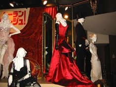 Satine's red satin elephant love medley dress in Moulin Rouge  --  The Costumer's Guide to Movie Costumes -   full description of construction at www.powerhousemuseum.com/collection/database/?irn=383441
