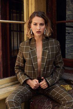 Tess Ward Tatler October Fashion Shoot - Wool blazer, wool trousers both by Paul Smith. White-gold & diamond earrings by Van Cleef & Arpels