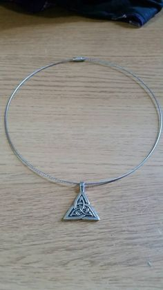 Check out this item in my Etsy shop https://www.etsy.com/uk/listing/244625002/celtic-triskele-pendant-on-stainless