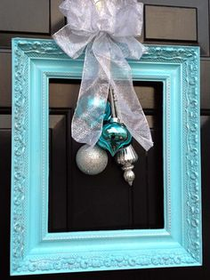 Turquoise Christmas Frame Wreath - clever and inexpensive. Might be difficult to keep from flopping every time you opened the door though Christmas Door Decorations, Christmas Frames, Christmas Holidays, Christmas Wreaths, Christmas Ornaments, Christmas Photos, Christmas Yard, Yard Decorations, Holiday Pictures